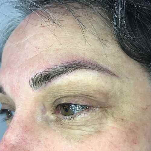 close up picture of microbladed eyebrows on client