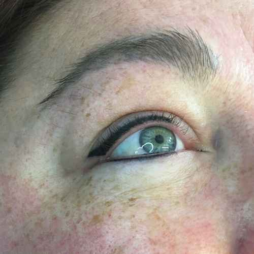 close up picture of semi permanent eyeliner on client
